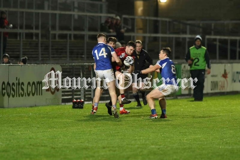 Downs-Niall-Donnelly-trys-to-break-free-with-the-ball-as-Laois-players-close-in