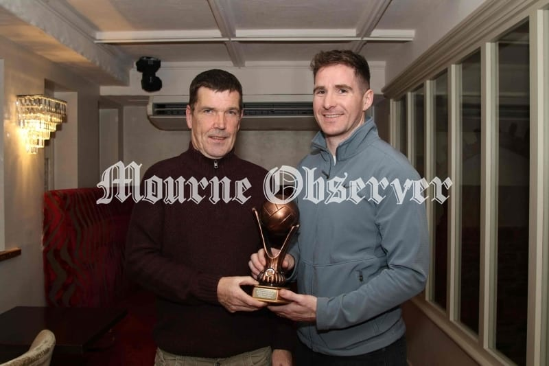 Aidan-Carr-receives-his-award-from-Paul-Rooney-Secrerary-DS