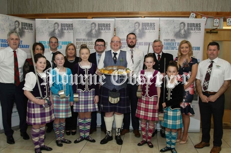 Gareth-Crozier-with-the-Haggis-and-Organisers-of-the-Robert-Burns-Night-Stephen,-Nicholson,-Esther-Nicholson,-John-Shields,-Joy-Cullen,-Christop