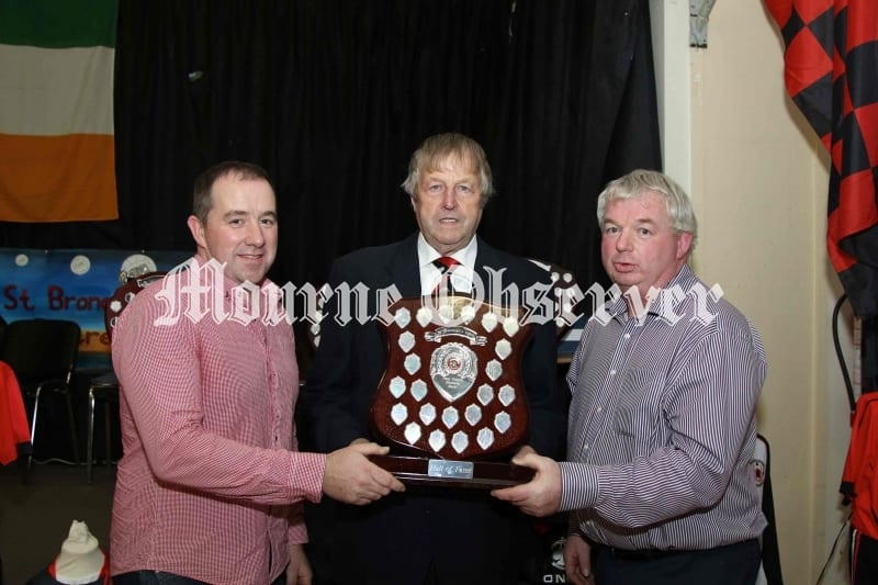 Former-Rostrevor-Footballer-George-Fearon-receives-the-Patsy-Tinnelly-Memorial-Shield-for-The-Hall-of-Fame-from-Gareth-&-John-Tinnelly