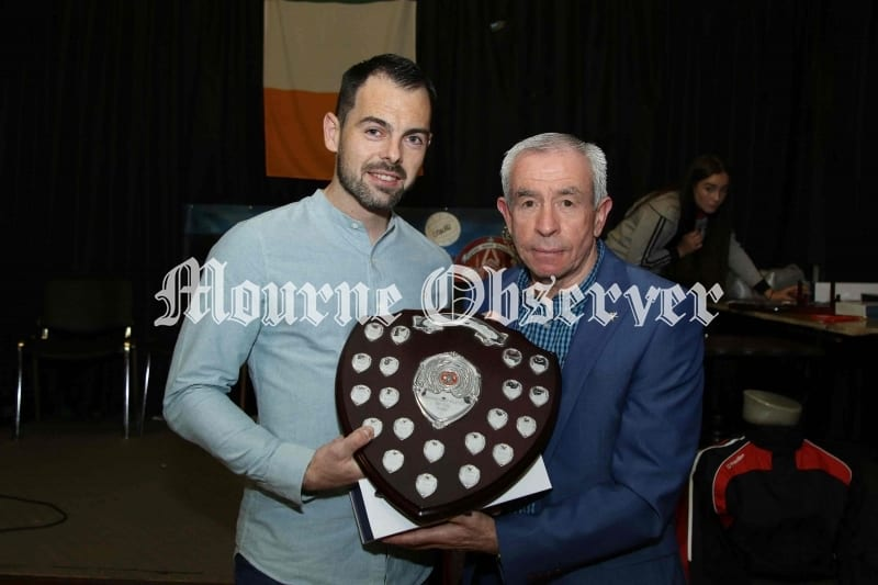 Shaun-Parr-receives-the-Player-and-Players-Player-award-from-Rostrevors-new-Senior-Team-Manager-Peter-McGrath