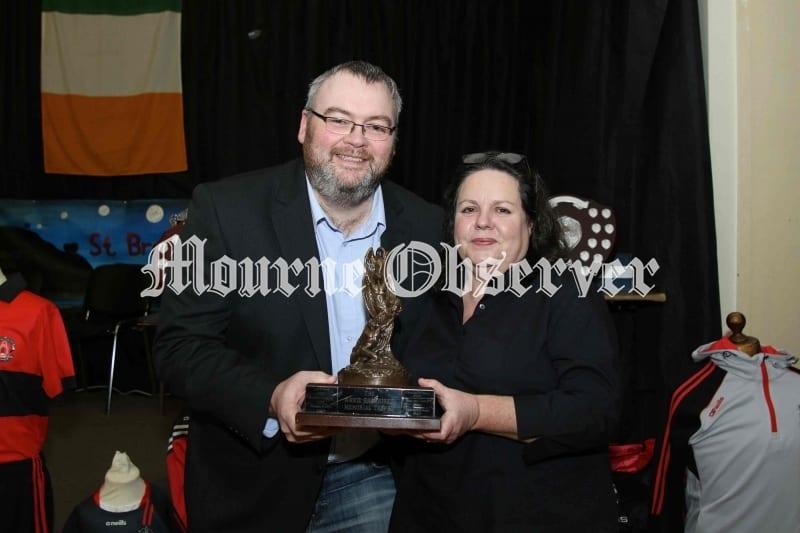 Female-person-of-Year-Deidre-McClorey-receiving-her-award-from-Ciaran-Sloan-Chairman-St-Bronaghs-GAA