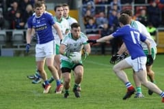 Burrens-Cathal-Foy-grabs-possession-of-the-ball-around-midfield