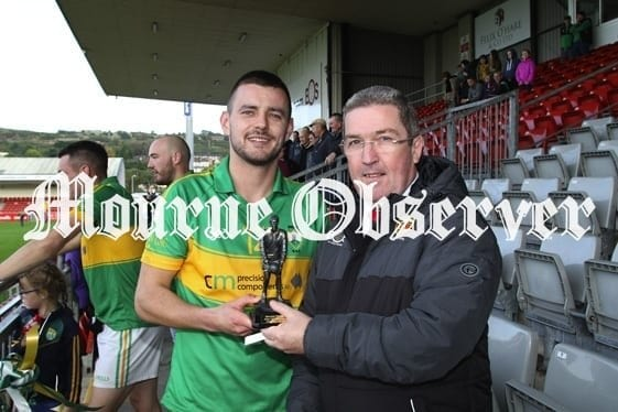 075728f2-mourne-observer-man-of-match-was-brights-gareth-george-receiving-his-trophy-from-county-chairman-sean-rooney