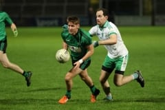 Castlewellens-Cahal-Crilly-gets-ahead-of-Burrens-Conaill-McGovern