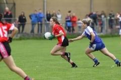 Alicia-McAlea-gets-away-from-Loughinislands-Bronagh-Murray