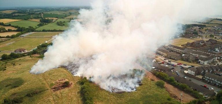Fire endangers dozens of homes