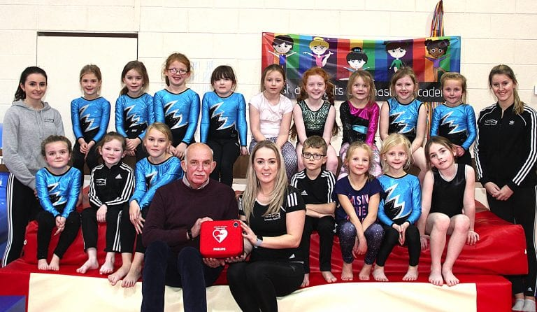 Twist and Splits Academy in Kilkeel presented with defibrillator by Heartbeat NI