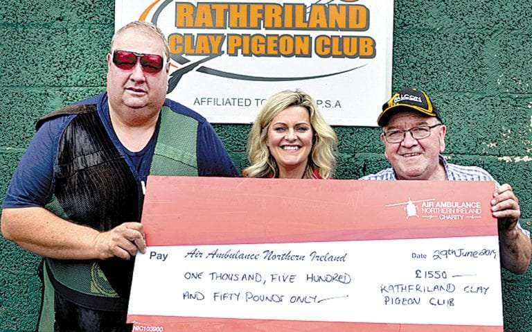 Rathfriland Clay Pigeon Club presents cheque