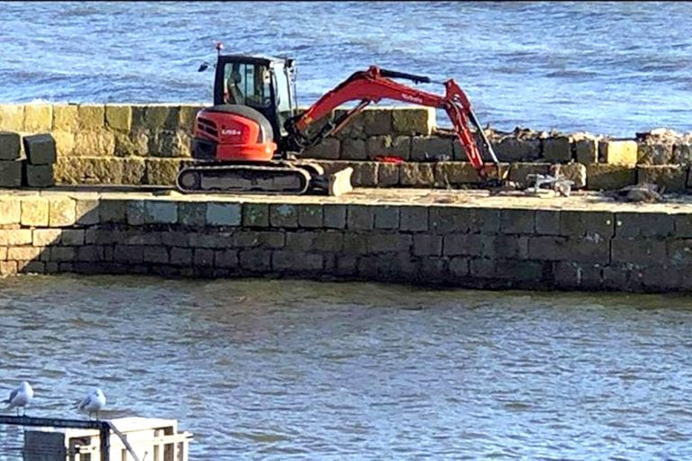 Work starts to preserve harbour's historic walls