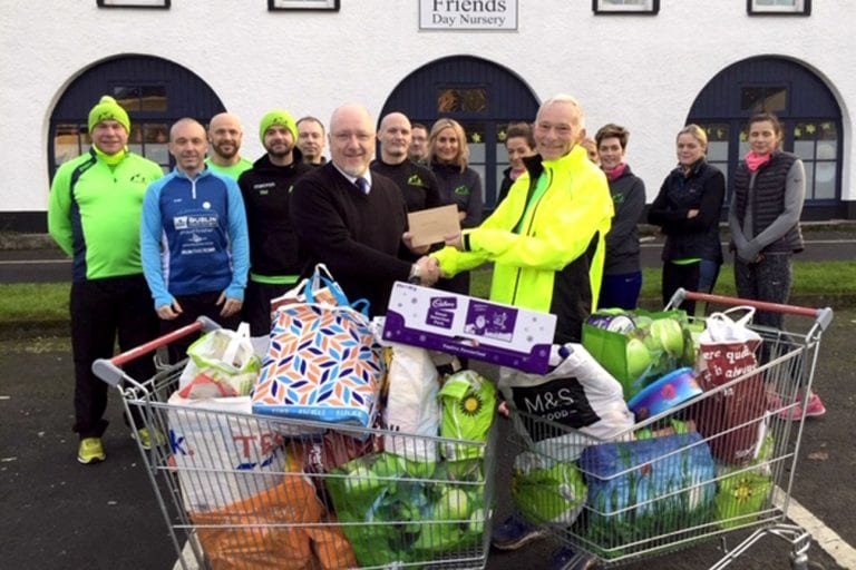 Crossgar Harriers present cheques and gifts to bring Christmas cheer