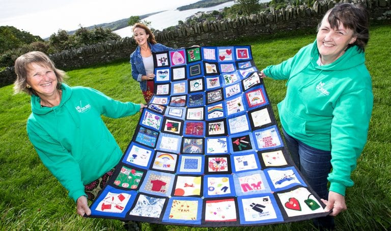 Patchwork quilt created as tribute to caring group