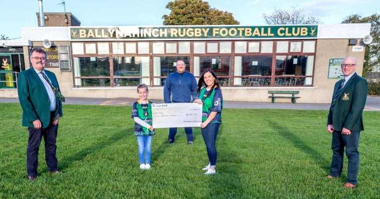 Ballynahinch Rugby Club presents shirt proceeds to Extern