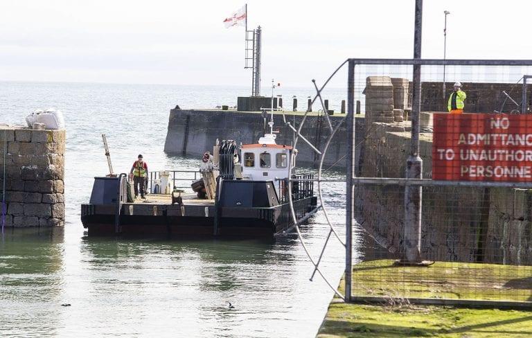 Initial work to repair village harbour begins